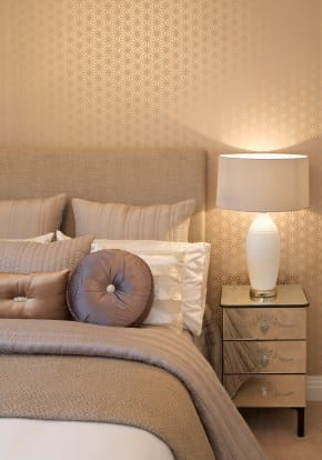 A bed, cushions and lamp