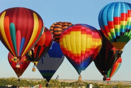 You don't have to commute by hot air balloon, but you can still enjoy them at the Albuquerque International Balloon Festival.