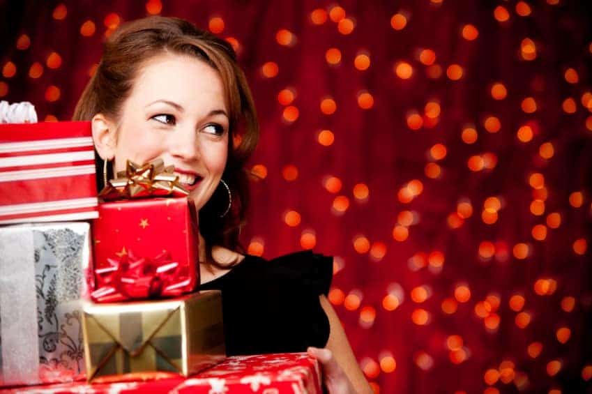 """Wow"" her this Christmas with gifts she'll love, including a sparkly phone case, dazzling jewelry and pretty bags."