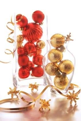 Repurpose old ornaments and display them in beautiful glass vases for a simple centerpiece.
