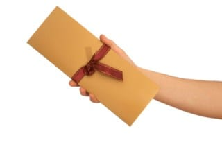 Save money on party invitations by hand delivering them to the people you see regularly.