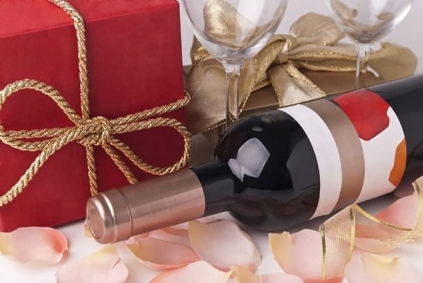 A bottle of wine makes a great housewarming gift, especially if you put a personalized label on it.