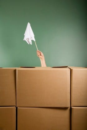 Downsizing to an apartment? Don't raise the white flag. Use our tips to stay sane.