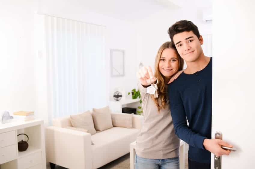 Young couple with keys to new apartment