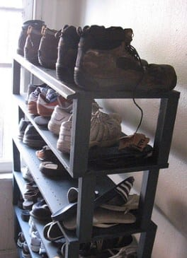 If you've got the vertical space, use it -- your shoes can fit nicely on a set of shelves.