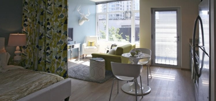 Studio Apartment Living. This studio apartment features a brightly colored curtain that separates  the bedroom area from rest 9 Tips to Make Your Studio Apartment Tiny Treasure