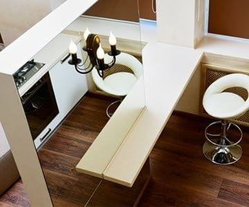 mirrors use illusion to open up a small apartment space