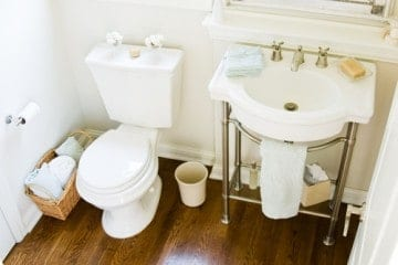 If your apartment bathroom doesn't have a vanity cabinet, you're going to have to get creative with your storage solutions.