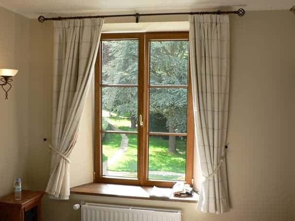 curtains add an extra layer of protection between your cozy apartment and the outside air