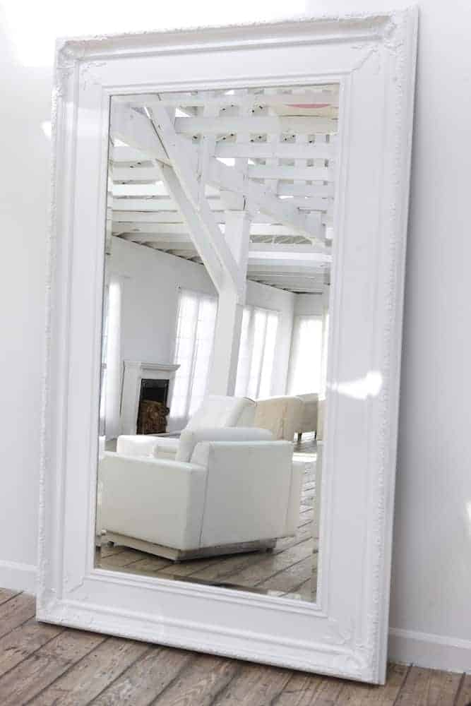 Small Apartment Decor A Guide to Decorating With Mirrors - Don't Be Afraid to Go Big