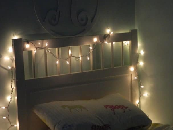 bed frame. 9 Easy Ways to Decorate Your Apartment with Fairy Lights