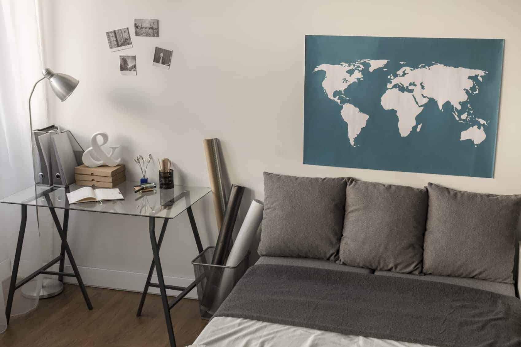 Apartment bedroom with world map on the wall
