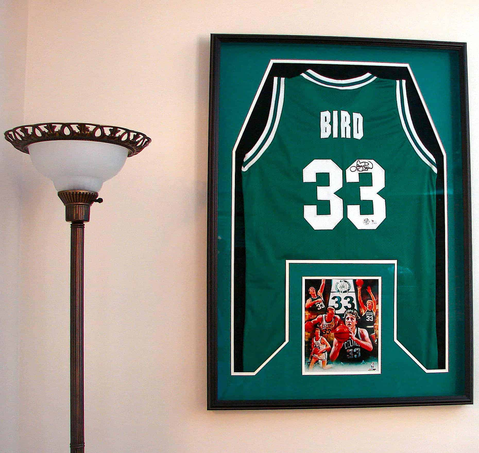 apartment decorating ideas that pay homage to your favorite sports team frame your jerseys
