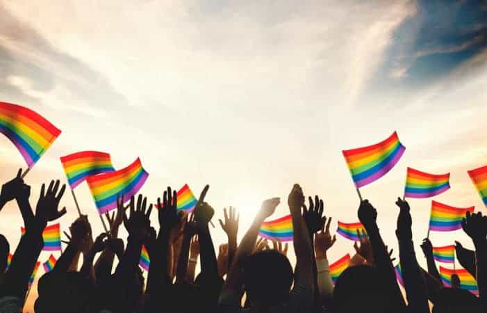 Gay Rainbow Flag Crowd Celebrating National Coming Out Day
