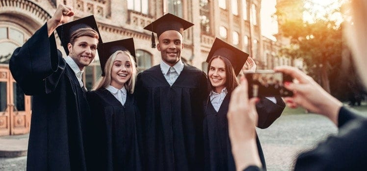 college students posing for graduation picture