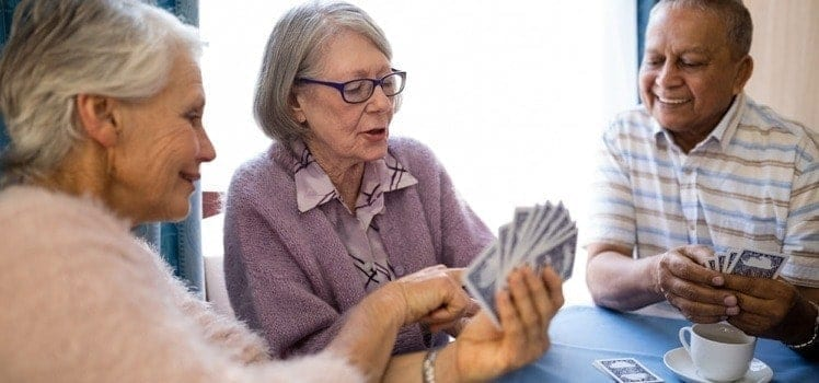 active seniors playing cards