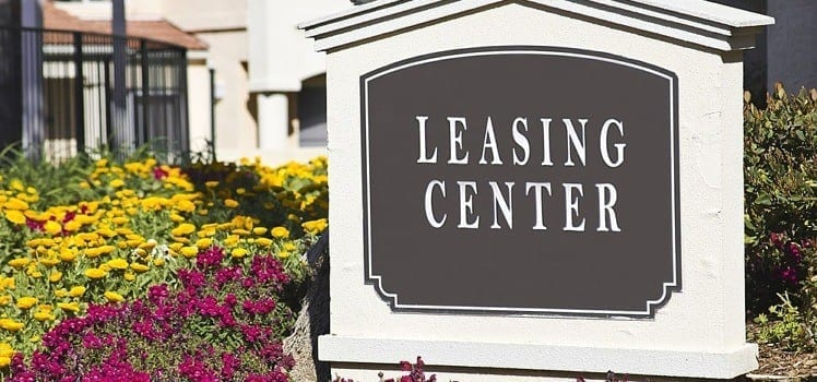 leasing center sign at apartment complex