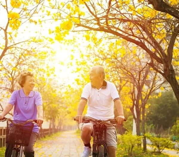 active seniors riding bikes at a CCRC