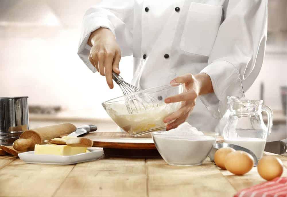 person baking a cake