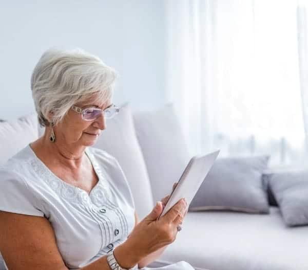 elderly woman on tablet