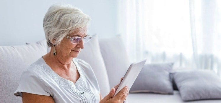 elderly woman on tablet