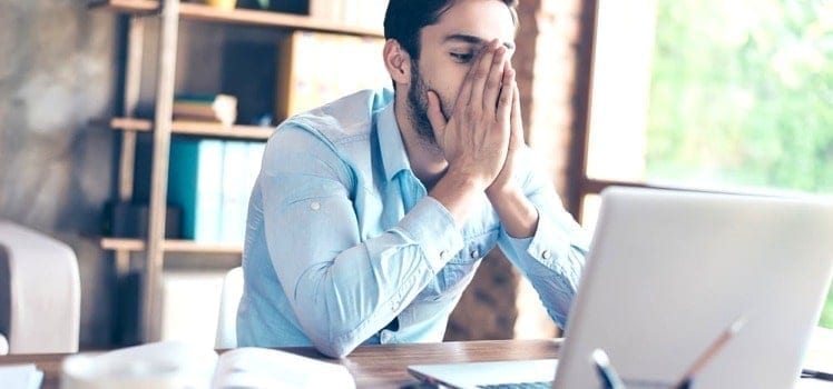 frustrated man at his computer