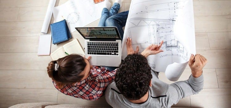 couple reading a floor plan