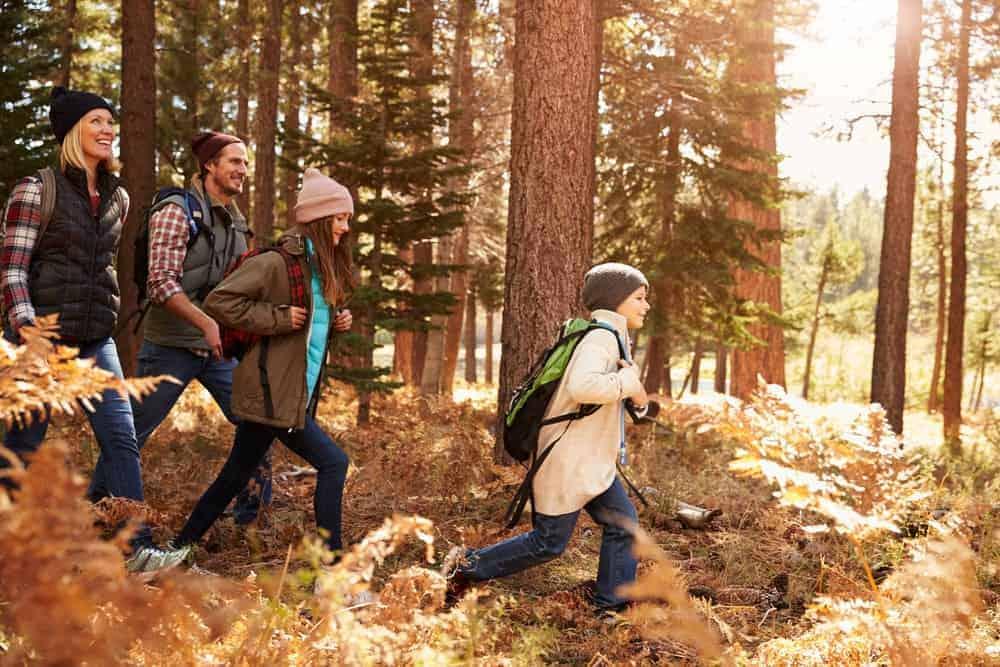 family hiking through nature