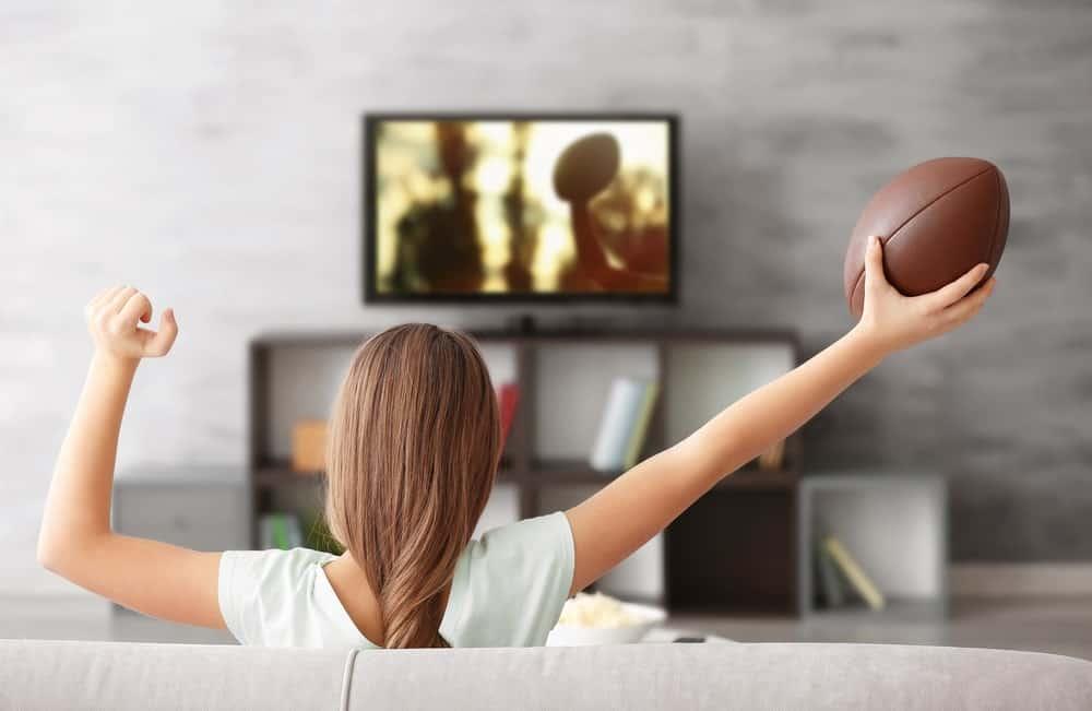 girl watching football