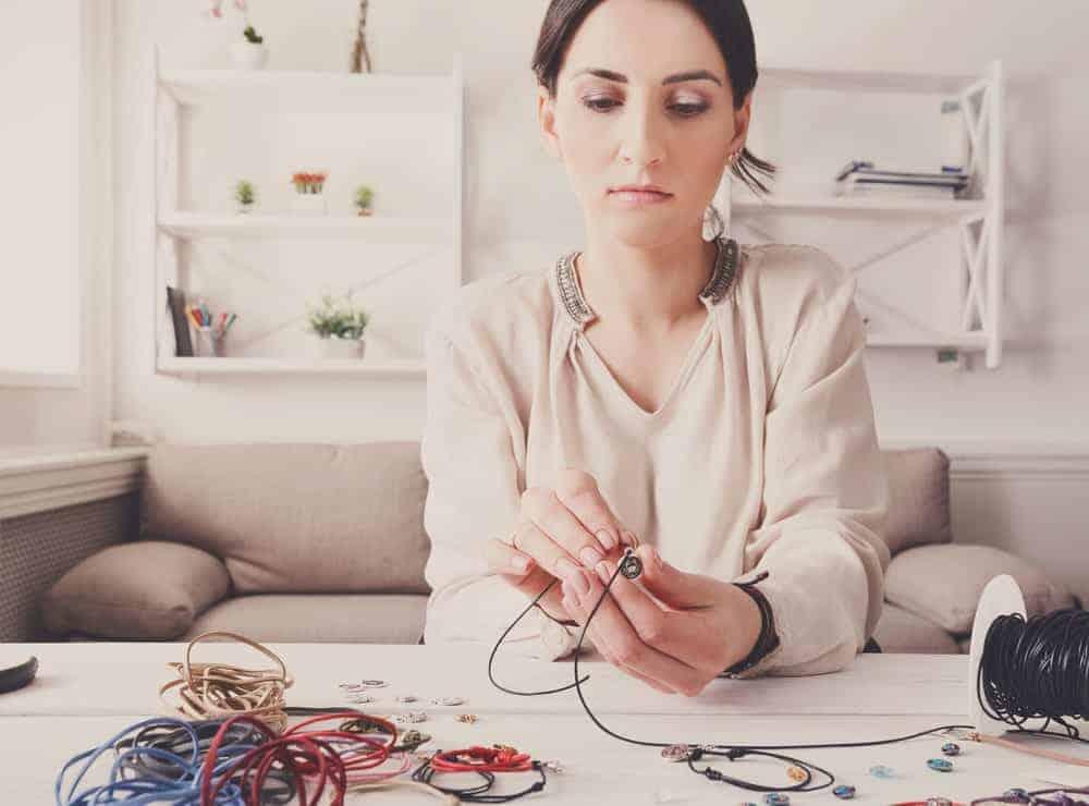 woman making bracelets