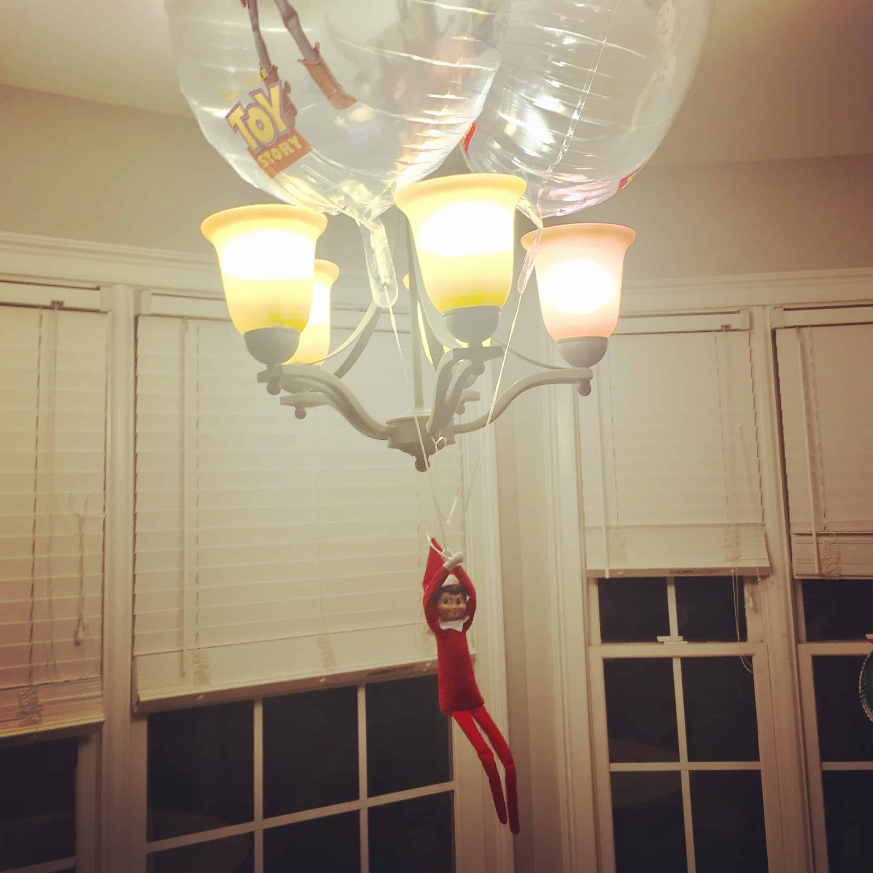 elf hanging from light