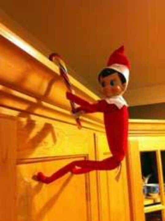Elf climbing with candy cane