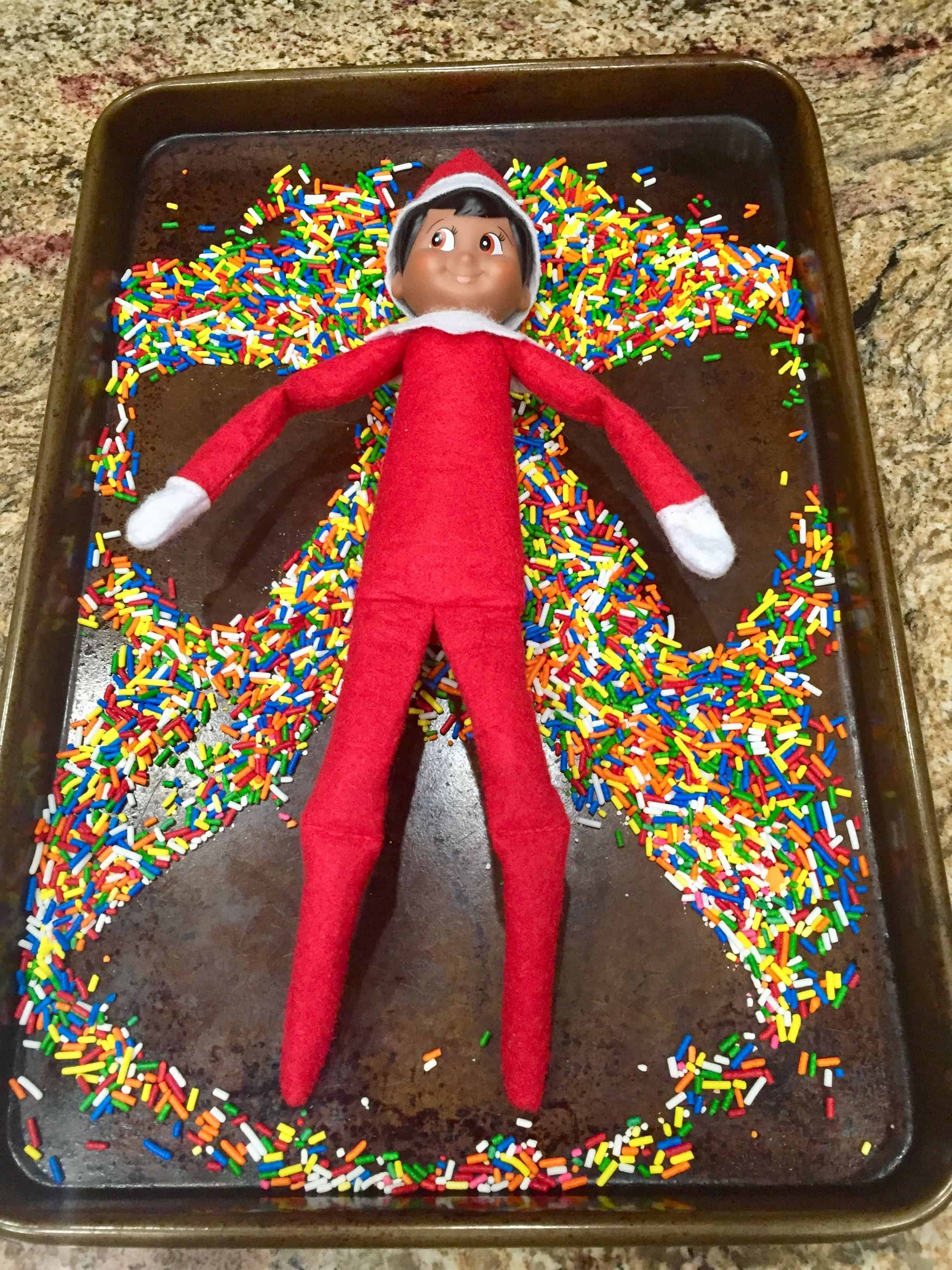 elf making a snow angel of sprinkles