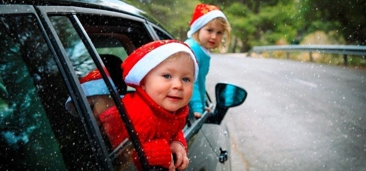 kids in car with santa hats