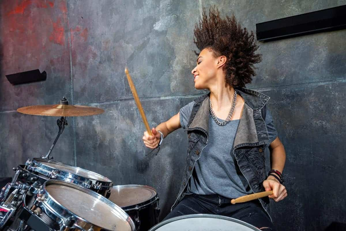 girl playing drums