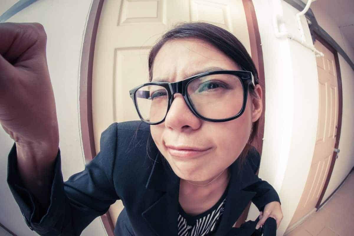 woman looking in peephole
