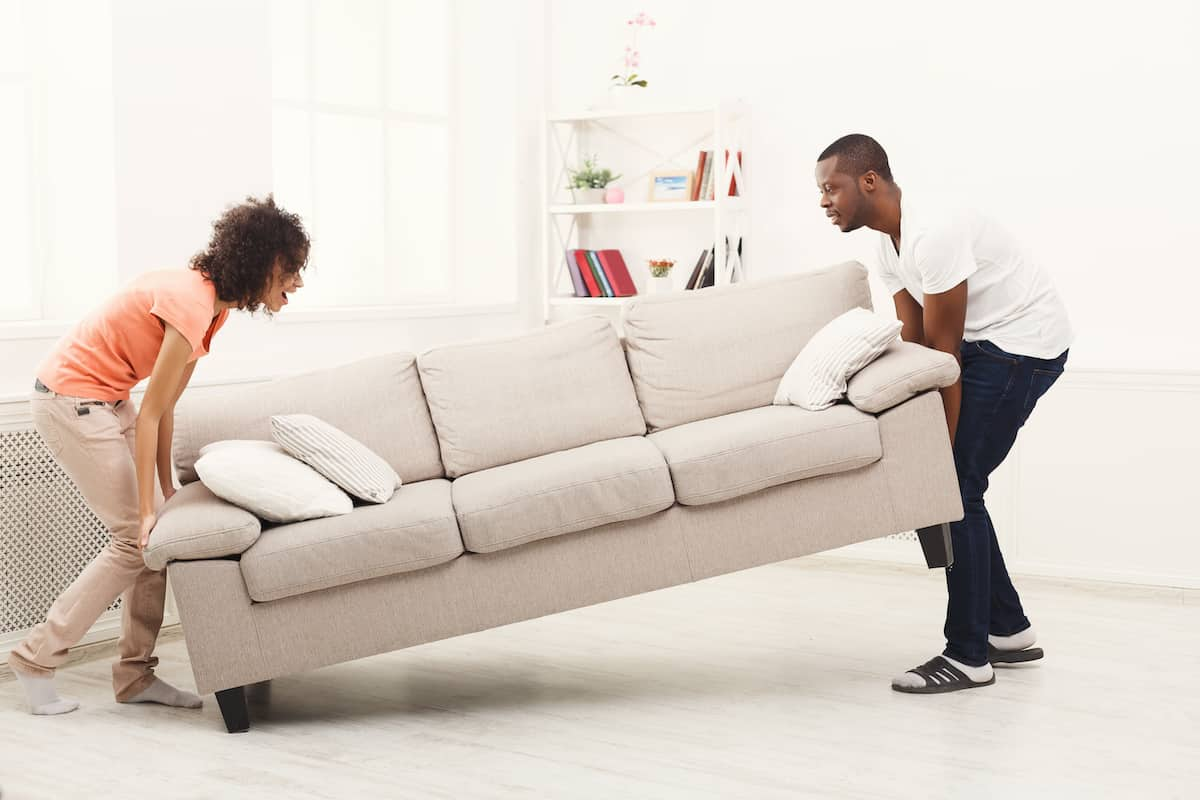 people moving a couch
