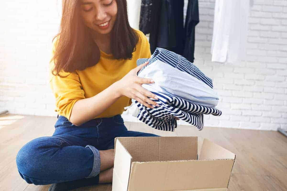 woman decluttering apartment