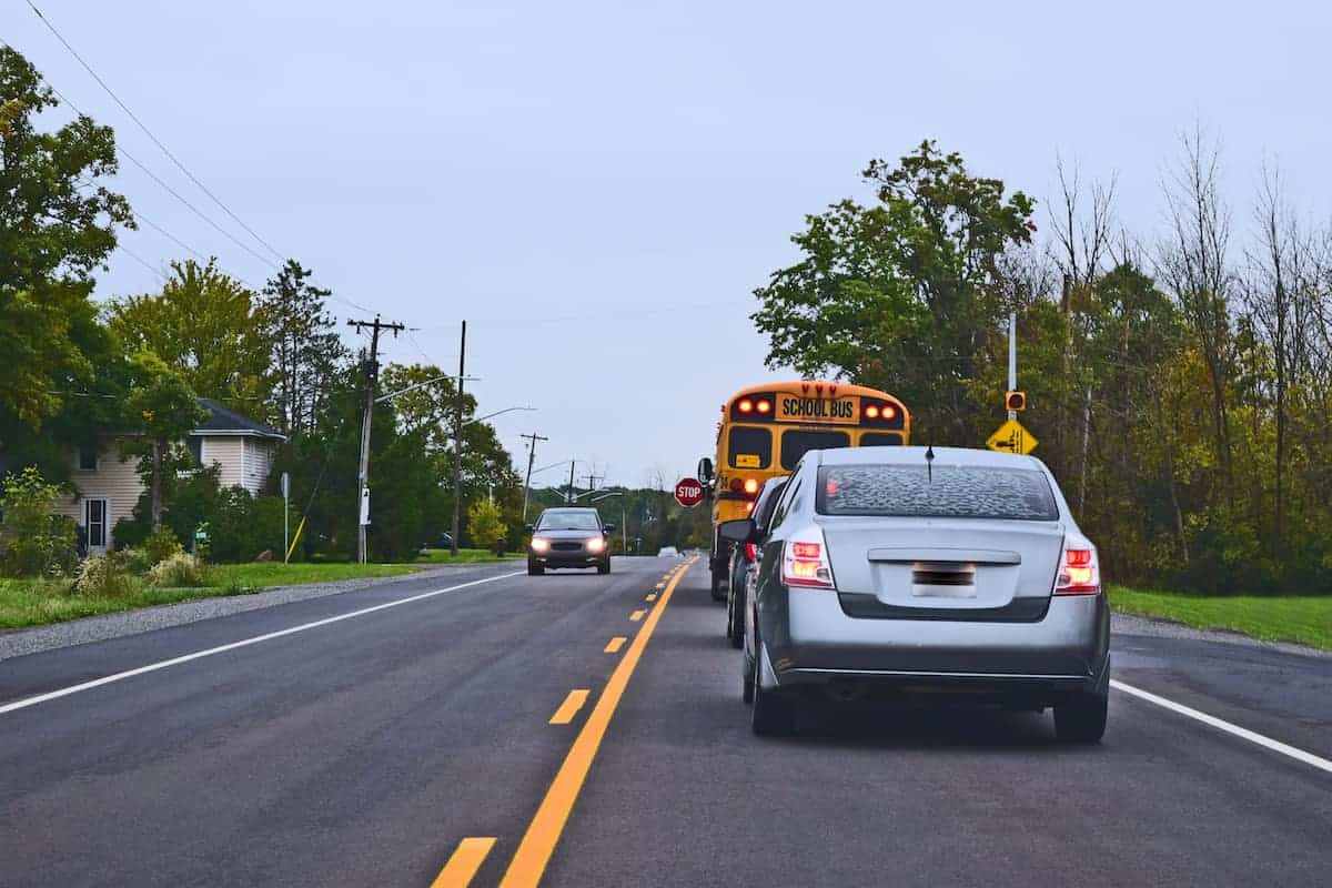 cars behind school bus