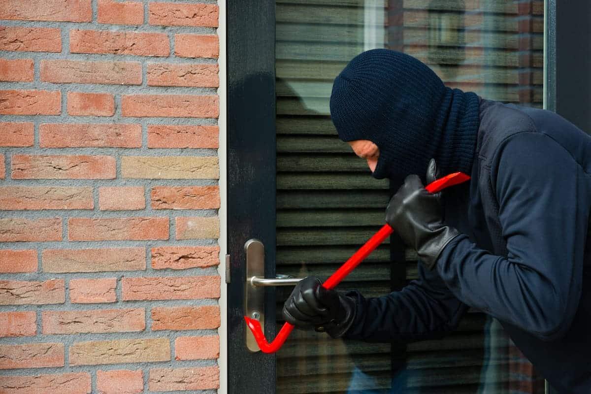 burglar breaking locks