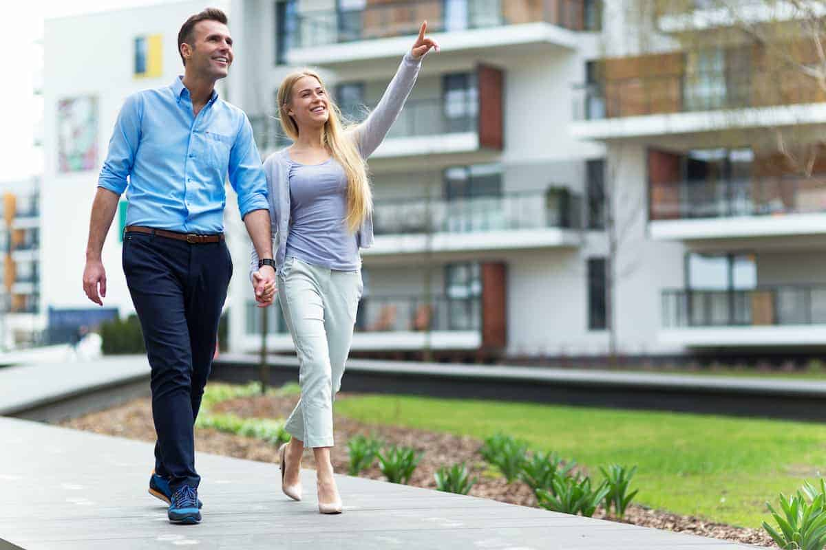 Couple walking at apartment complex