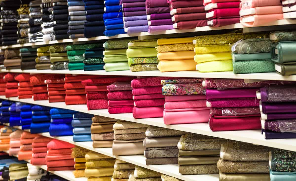 Rows of colorful bolts of fabric ready for use to help decorate your apartment