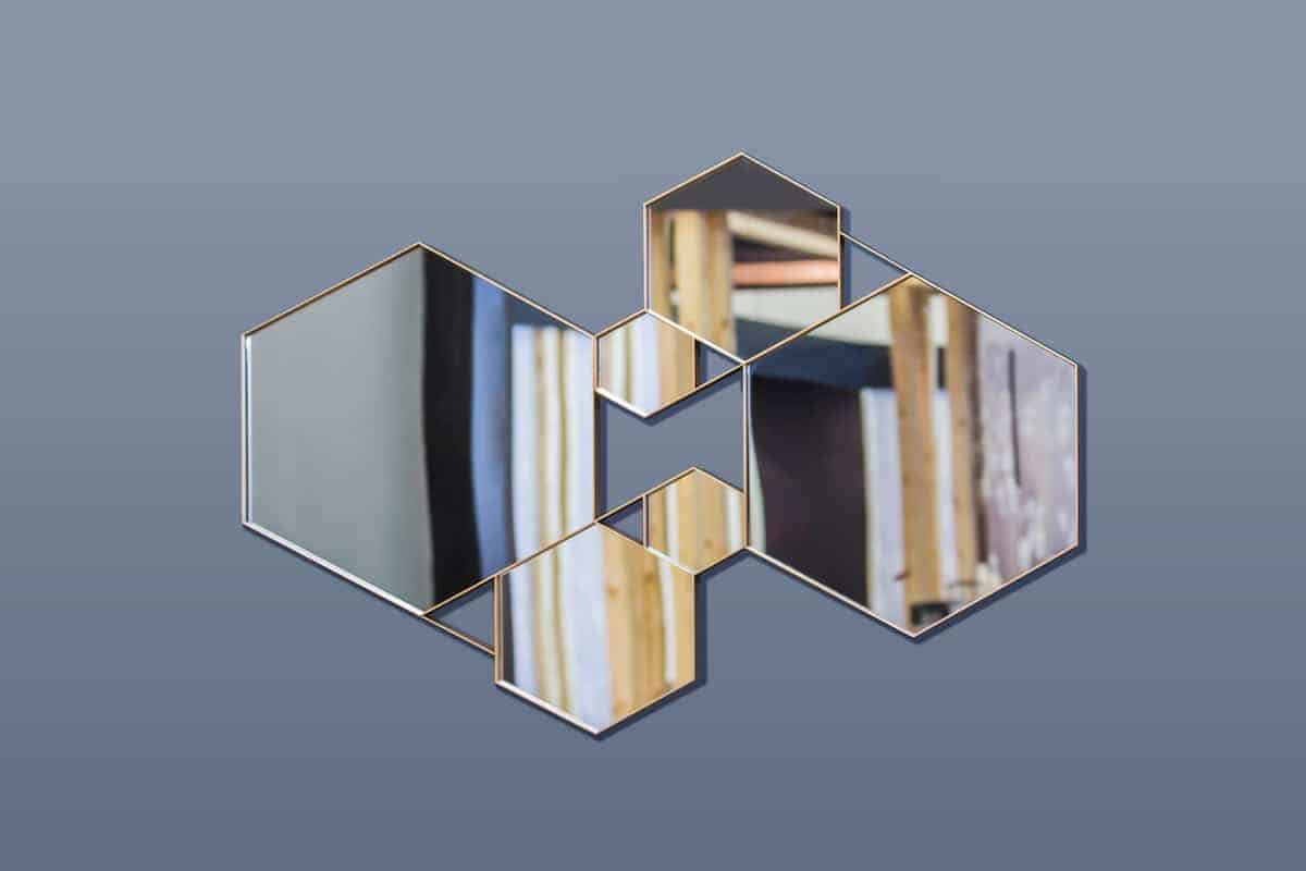 Hexagon-shaped mirrors used as a statement piece on a wall