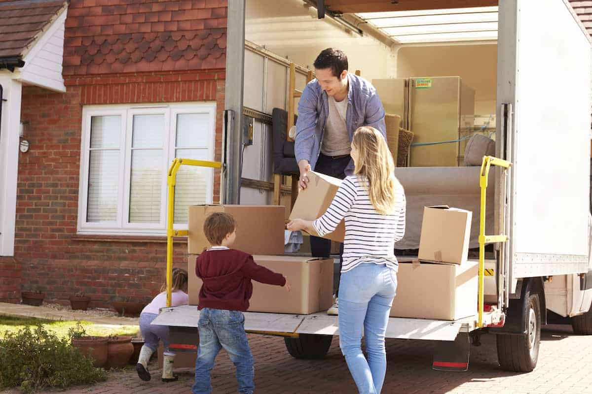 photo showing family moving boxes