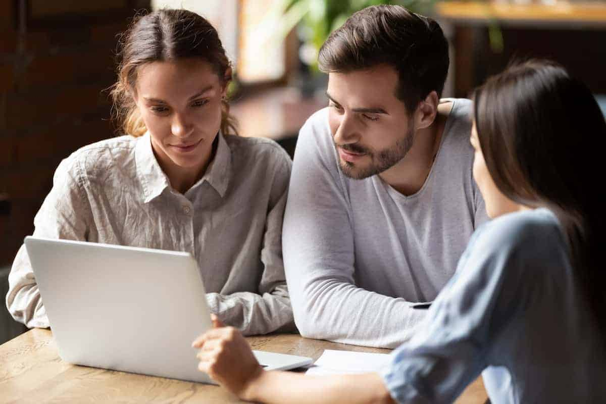 Young couple reviewing rent increase with property manager