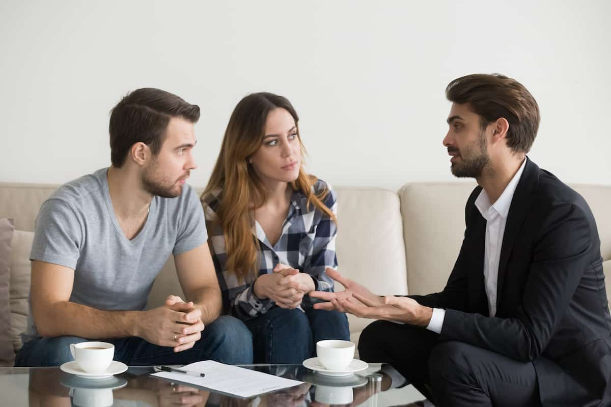 photo of couple talking to their landlord