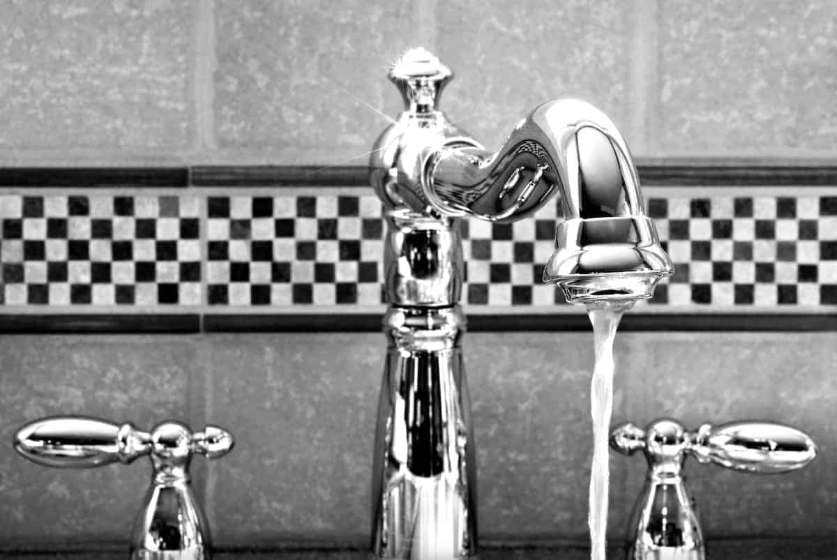 Decorative, checkered tile behind the bathroom faucet
