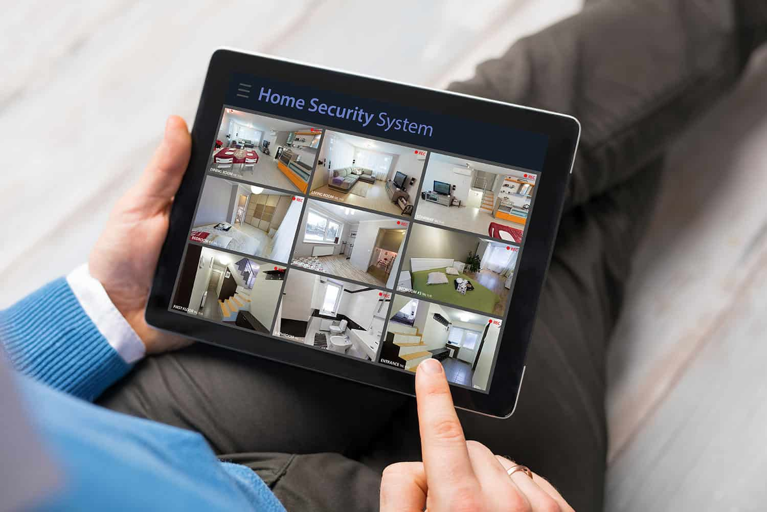 person looking at home security system