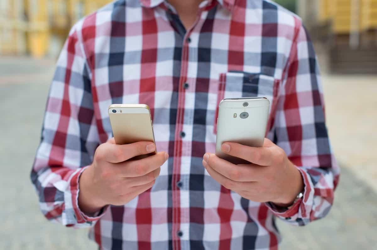 man comparing phones