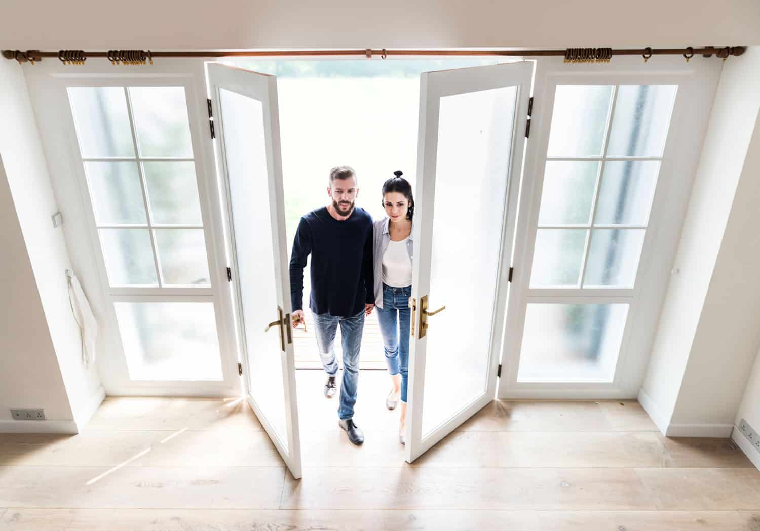 couple walking into house